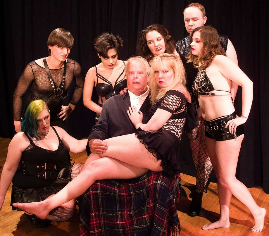"""Pictured with """"Dr. Scott,"""" played by Ed Hobson, are Gabbie Hirth, Melissa Madzek, Steven Schmidt, Nicole Singh, Ari Doyle, Brendon Rogers and Courtney Malanga. """"The Rocky Horror Show"""" is being performed by the Phoenix Theater Company at the Durham Town Hall Theater. Photo: Contributed Photo /"""