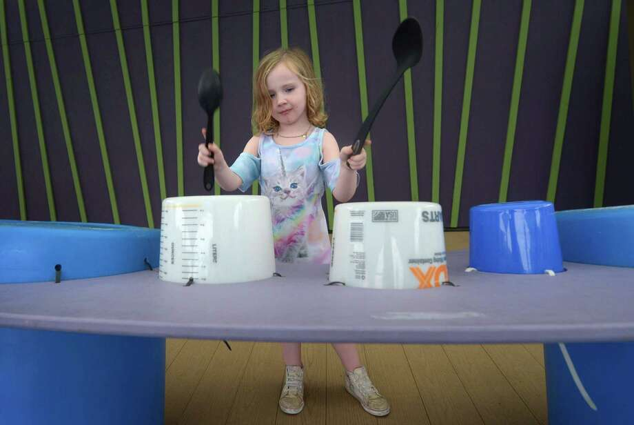 Caitlin McGrath, 5, plays on the Found Sound exhibit which repurposes household items as musical instruments at Stepping Stones Museum for Children Tuesday, October 9, 2018, in Norwalk, Conn. Stepping Stones will host its first ever Sustainability Expo, partnering with Fairfield-based business Sustainne, which promotes sustainable living. The expo will run 10 am to 2 p.m. this Saturday. Photo: Erik Trautmann / Hearst Connecticut Media / Norwalk Hour