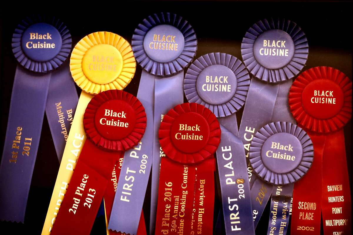 Yvonne Hines, owner of Yvonne's Southern Sweets, located at 5128 Third St., in San Francisco, Calif., has multiple ribbons on display in her shop on Tuesday, October 9, 2018. The small business, known for its butter cookies and pies, is less than two miles from the Warriors� forthcoming Chase Arena.