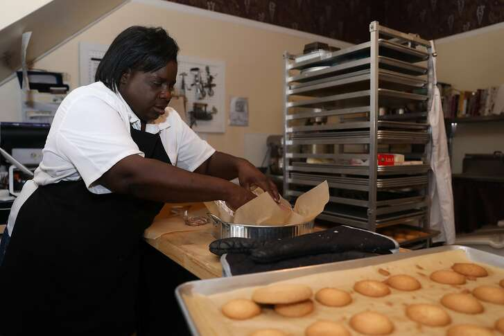Yvonne Hines, owner of Yvonne's Southern Sweets, works in her shop, located at 5128 Third St., in San Francisco, Calif., on Tuesday, October 9, 2018. The small business, known for its butter cookies and pies, is less than two miles from the Warriors� forthcoming Chase Arena.