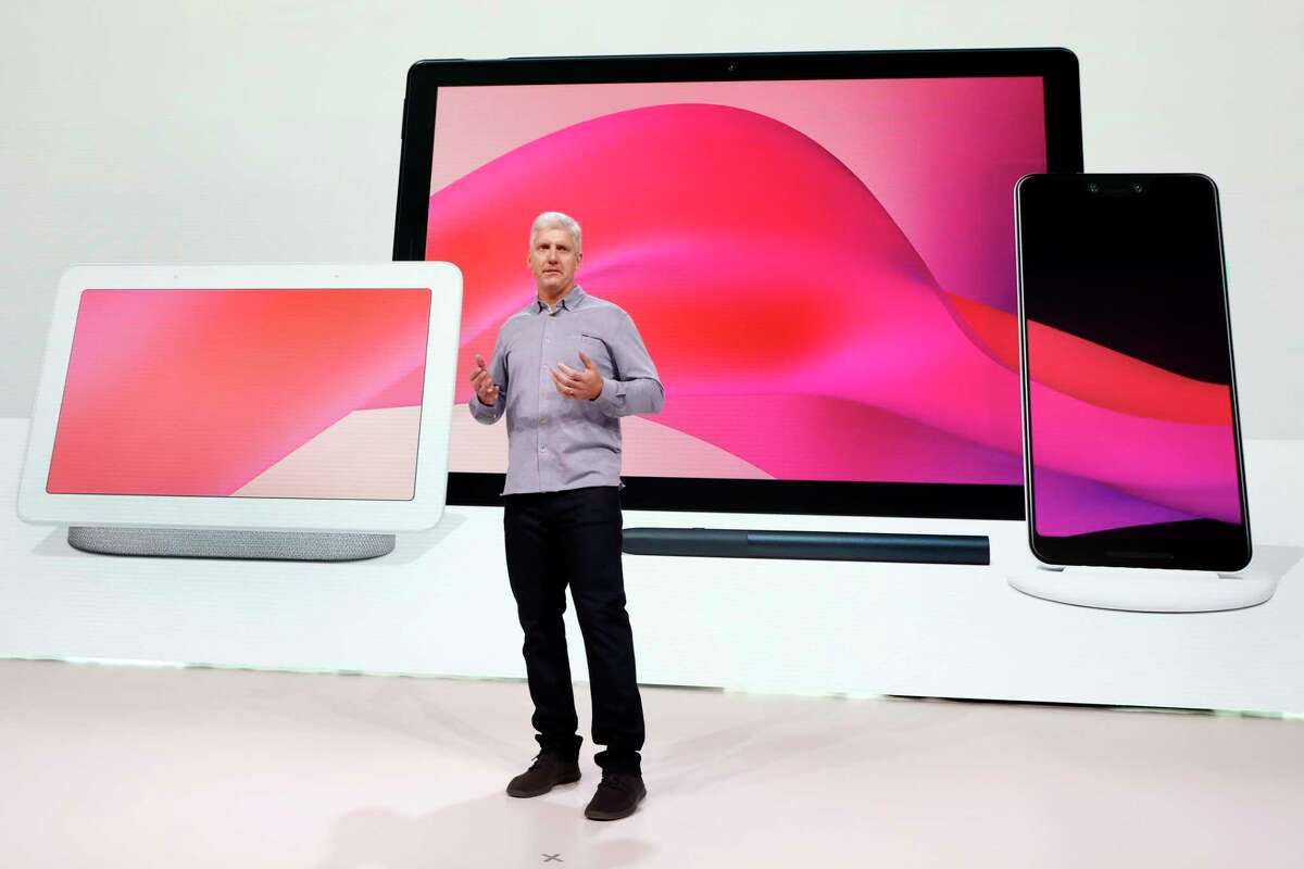 Rick Osterloh, Google's Senior Vice President of hardware, talks about new Google products during a presentation in New York, Tuesday, Oct. 9, 2018. Google introduced two new smartphones, the Home Hub, left, and Pixel Slate, center, in its relentless push to increase the usage of its digital services and promote its Android software that already powers most of the mobile devices in the world. (AP Photo/Richard Drew)
