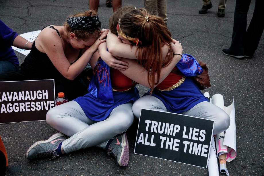 Protesters comforted each other in front of the Supreme Court building as the Senate voted to confirm Judge Brett Kavanaugh to the Supreme Court Saturday. Democrats can use this confirmation to turn out of the vote. If they don't, they deserve to lose. Photo: DAMON WINTER /NYT / NYTNS
