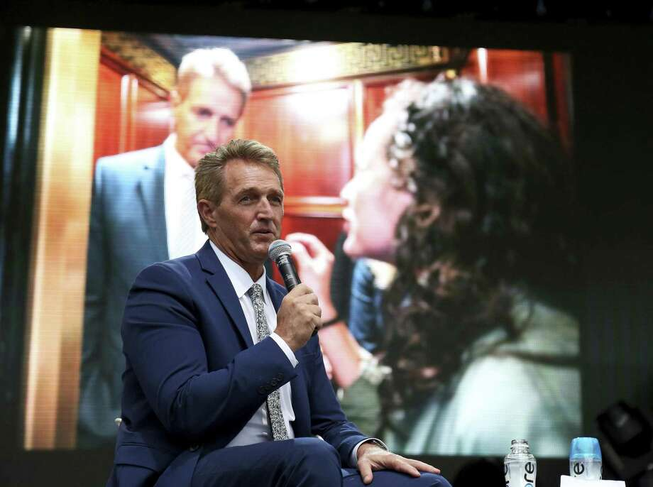 People are meaner, angrier and unhappier. The elevator ambush of Sen. Jeff Flake, R-Ariz., shows how Americans are getting in each other's faces and questioning each other's motives. Photo: Mary Schwalm / Associated Press / Copyright 2018 The Associated Press. All rights reserved.