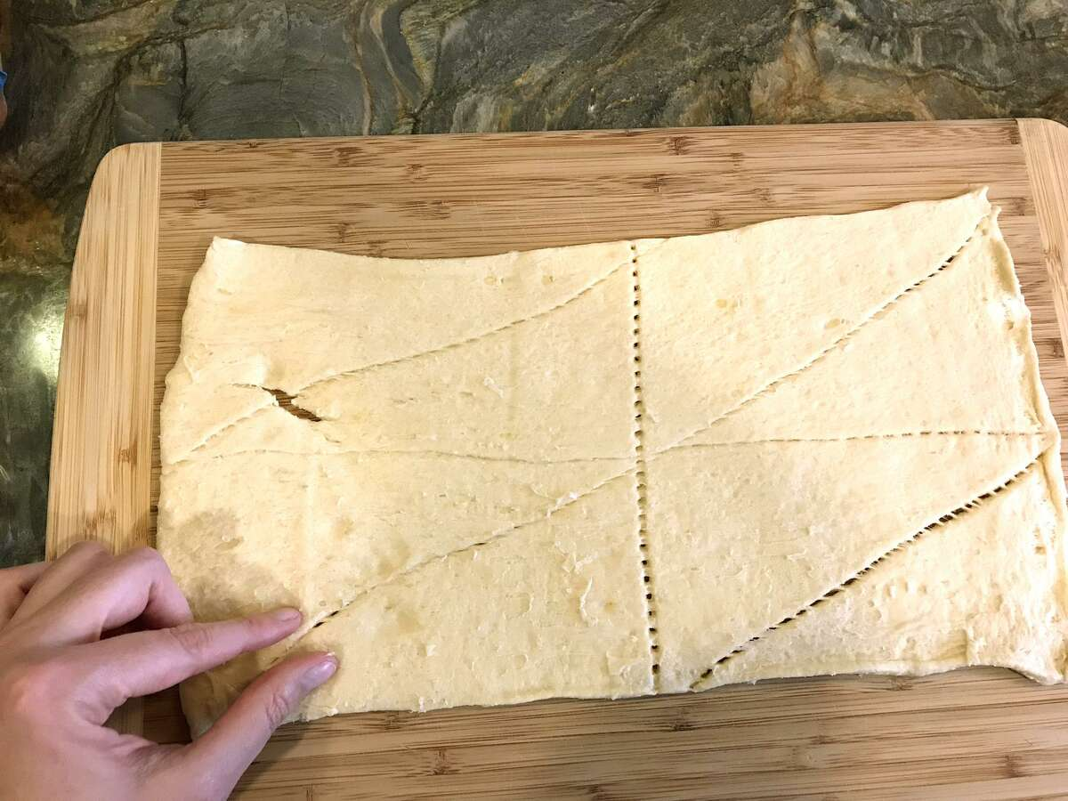 After you unroll your crescent dough, pinch together the seams.