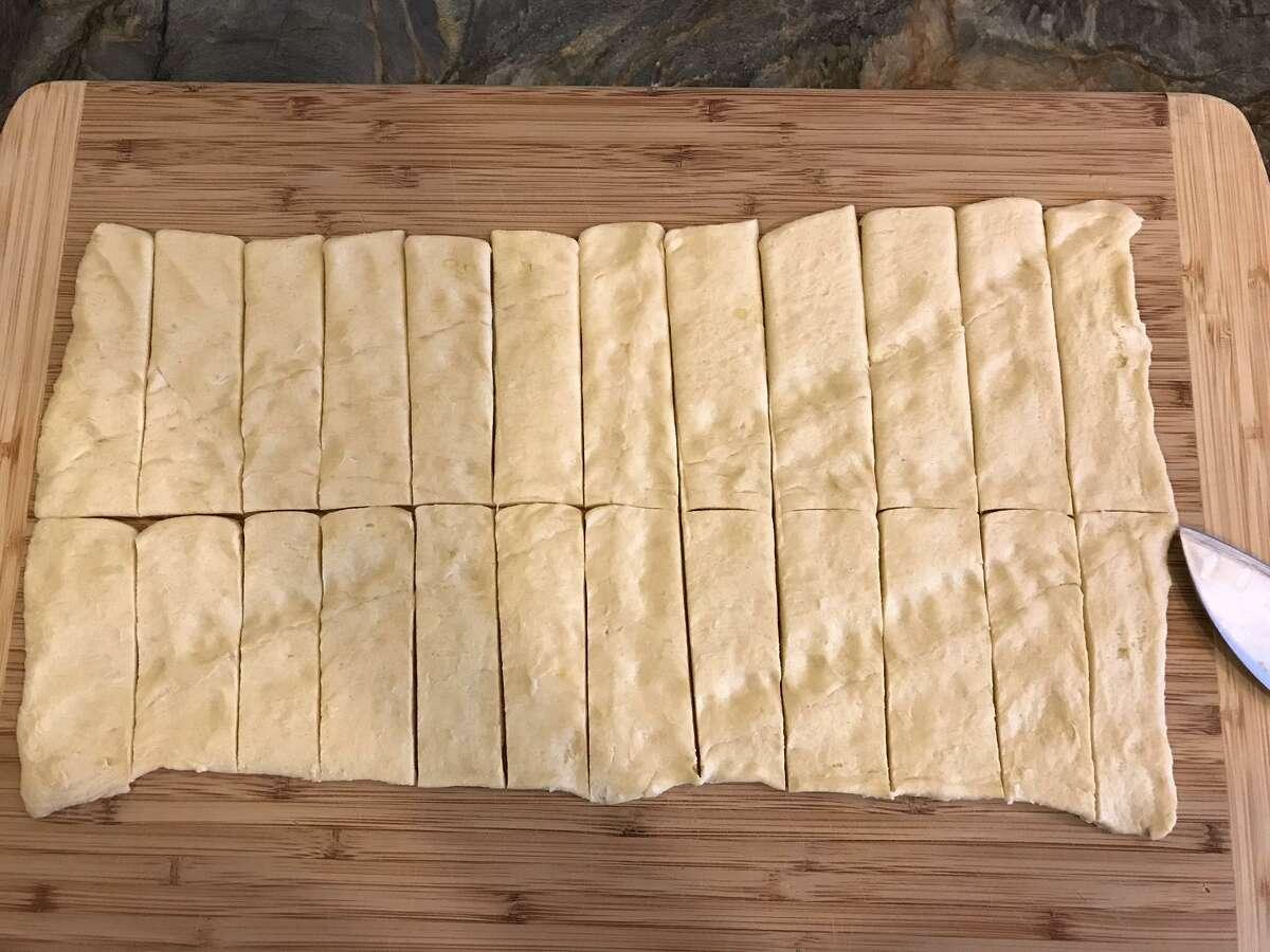 Cut the dough into 24 strips.