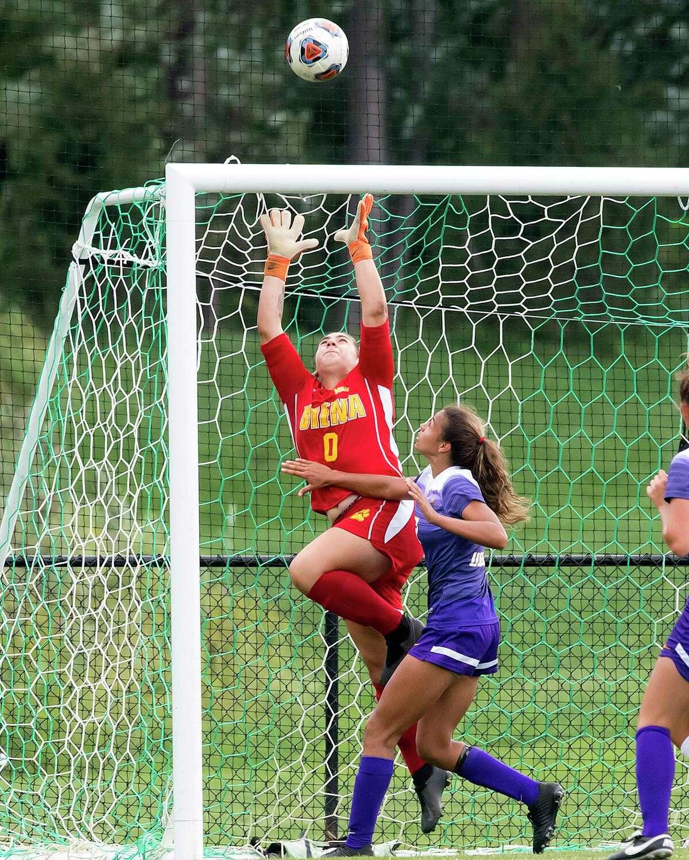 Siena College women's soccer goaltender Taylor Dorado makes a save.