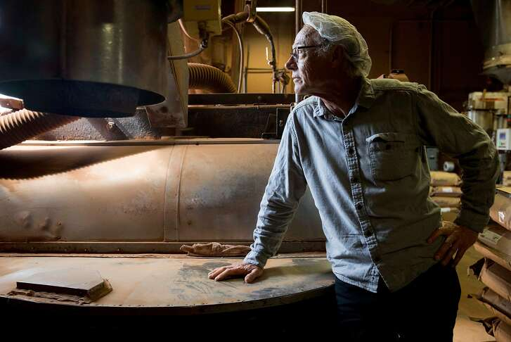 Fifth-generation Chocolatier Gary Guittard poses for a portrait next to one of the original mills inside the Guittard Chocolate Company headquarters in Burlingame, Calif. Wednesday, Sept. 26, 2018.