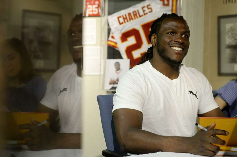 "Jamaal Charles, a Port Arthur native who plays for the Denver Broncos, signs copies of his book ""The Middle School Rules of Jamaal Charles"" at the Museum of the Gulf Coast on Friday.  Photo taken Friday 6/9/17 Ryan Pelham/The Enterprise Photo: Ryan Pelham / Ryan Pelham/The Enterprise / ©2017 The Beaumont Enterprise/Ryan Pelham"