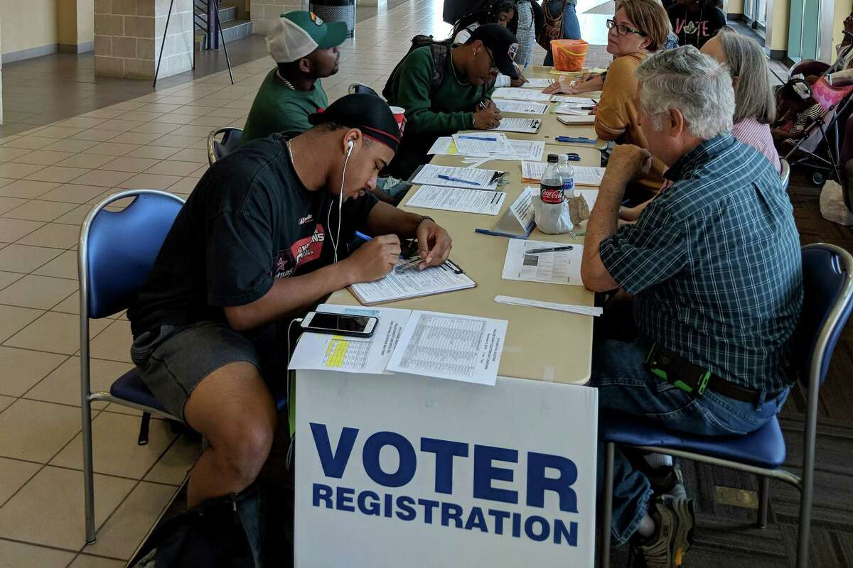 Prairie View A&M University students register to vote on Tuesday, the deadline to be able to cast a vote in the November election in Texas.