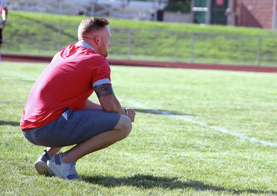 Alton boys soccer coach Nick Funk's Redbirds are 6-6-6 after a 3-3 tie Monday night with Waterloo Gibault. Funk is shown on the sideline during a game earlier this season.