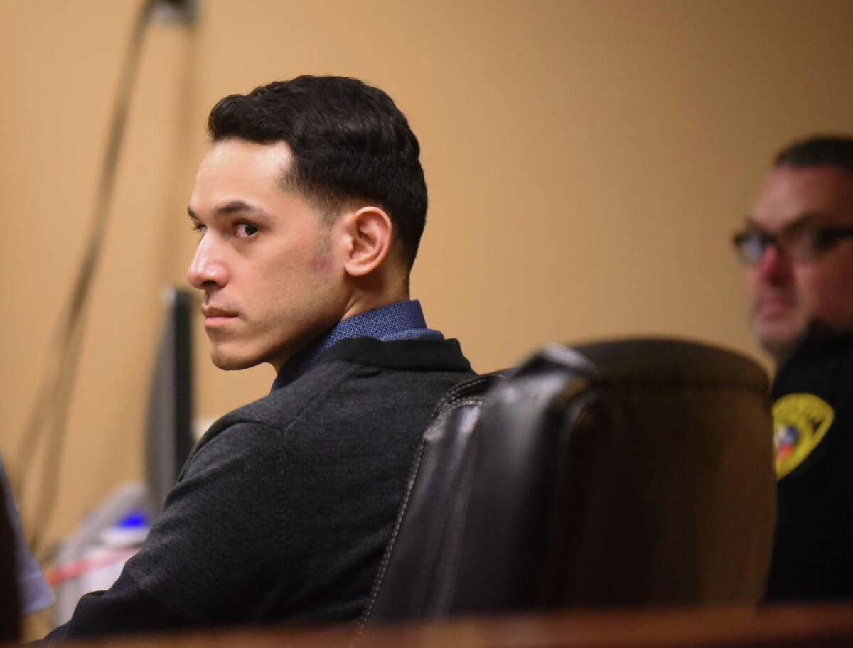 Defendant Adrian Vigil, who is accused of two counts of super aggravated sexual assault on a minor, sits in Felony Impact Court on Tuesday, the first day of his retrial, presided over by visiting Judge Philip A. Kazen on Tuesday, Oct. 9, 2018.