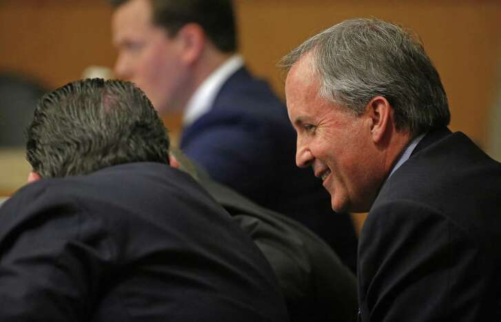 Texas Attorney General Ken Paxton (right) smiles during his pretrial hearing at Collin County Courthouse in McKinney, Texas, Thursday, Feb. 16, 2017. (Jae S. Lee/The Dallas Morning News)