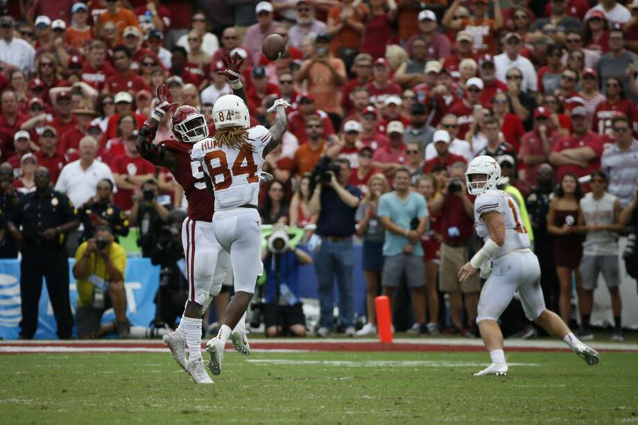 Oklahoma Sooners defensive end Kenneth Mann (55) pressures Texas Longhorns wide receiver Lil'Jordan Humphrey (84) as he passes to quarterback Sam Ehlinger (right) in the first half of an NCAA college football game, Saturday, Oct. 6, 2018, in Dallas, Texas. (AP Photo/Roger Steinman) Photo: Roger Steinman/Associated Press
