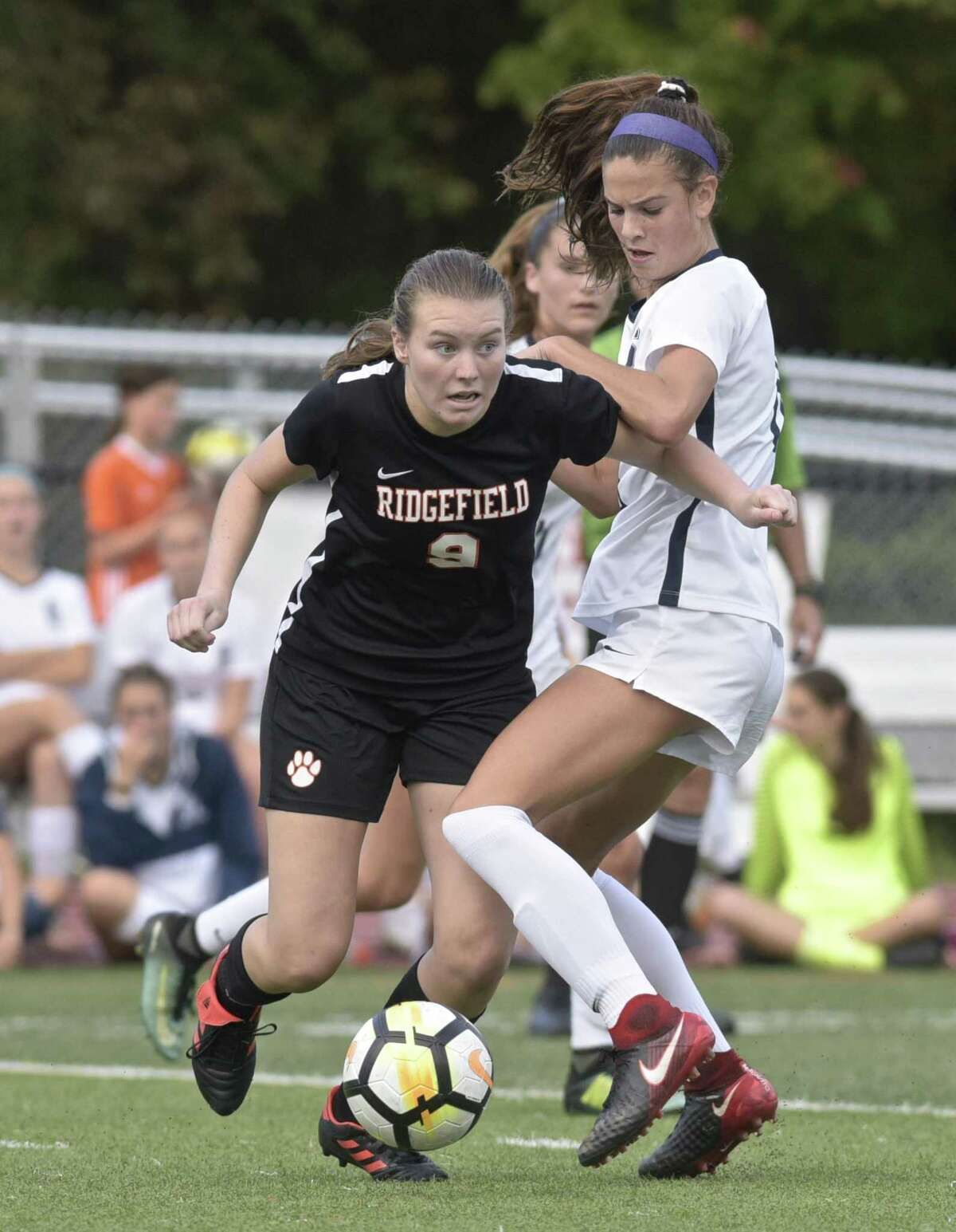 Ridgefield's Mackenzie Robson, left, tries to go around Staples' Mia Gonzalez in Tuesday's game at Ridgefield.