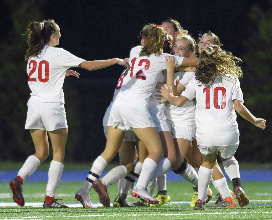 New Canaan's Olivia Bognon (13) celebrates with her teammates after scoring a goal against Darien in the second half of an FCIAC girls soccer game on Oct. 9, 2018 in Darien, Connecticut. New Canaan went on to win 1-0 against rival Darien. Photo: Matthew Brown / Hearst Connecticut Media / Stamford Advocate