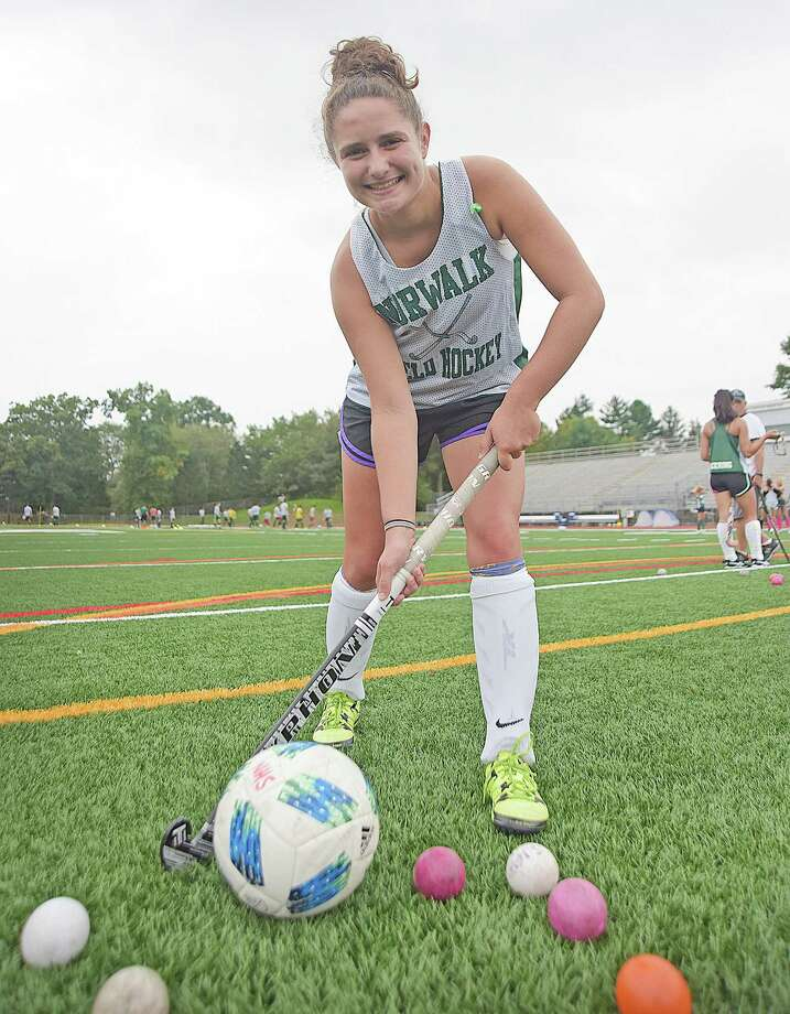 Norwalk High senior Julia Sferlazza made the rare switch from soccer to field hockey without ever having played the latter sport until this season. Now she's a starter on one of the most successful teams in the FCIAC. Photo: John Nash / Hearst Connecticut Media