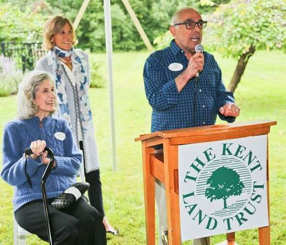 The Kent Land Trust held its fall benefit cocktail party Sept. 8 on the grounds of Bob Avian and Peter Pileskis North Kent residence. Above, Honorary Event Chair Nancy Kissinger and KLT Board Chair Jane Klein listen as host Bob Avian delights guests with welcoming remarks. Photo: Courtesy Of Kent Land Trust / The News-Times Contributed