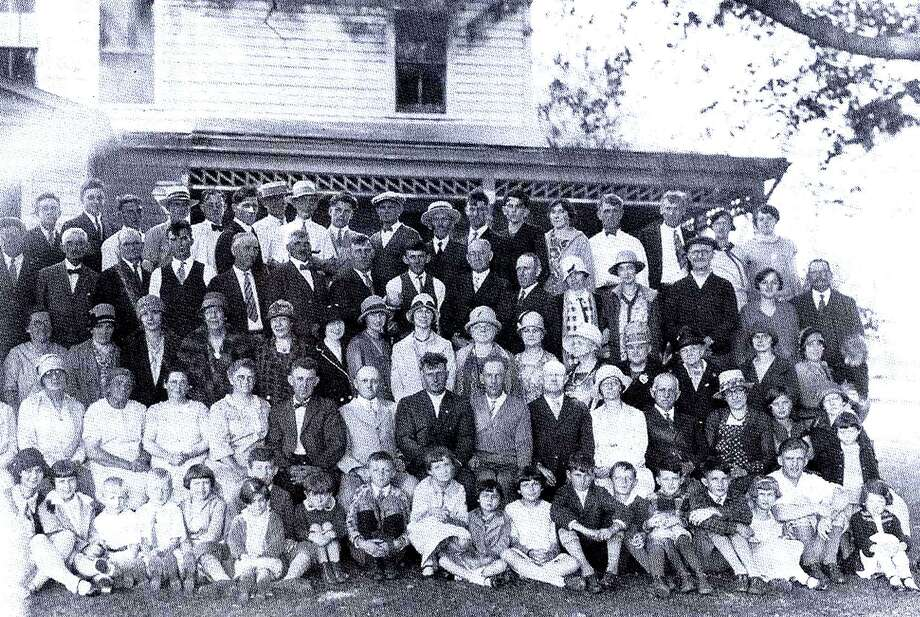 This photo depicts a large gathering of members of the Grange, one of the most prominent of the social and civic organizations, at the Curtis farmhouse in Bridgewater. Annual get-togethers served as an important part of the group's social outreach to th ecommunity. Photo: Contributed Photo / The News-Times Contributed