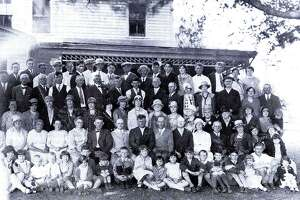 This photo depicts a large gathering of members of the Grange, one of the most prominent of the social and civic organizations, at the Curtis farmhouse in Bridgewater. Annual get-togethers served as an important part of the group's social outreach to th ecommunity.