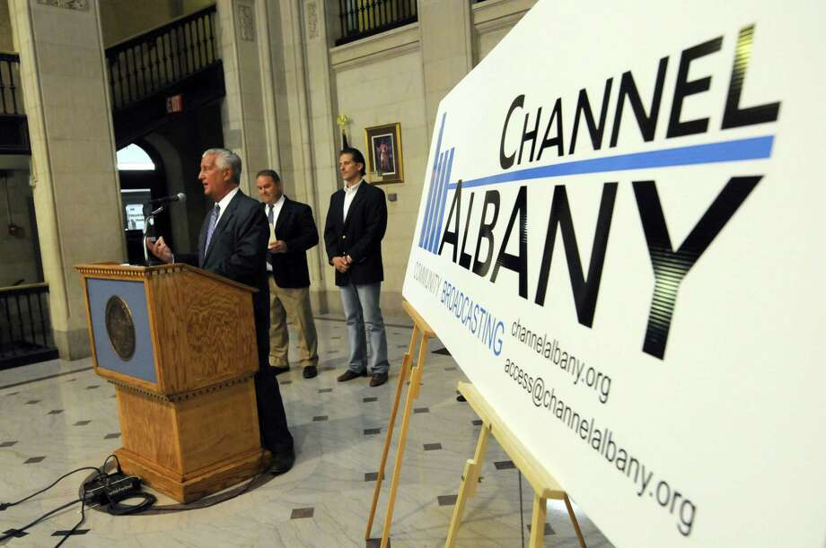 Mayor Gerald D. Jennings, left, announces the opening of Channel Albany Community Broadcasting during a press conference at City Hall in Albany N.Y. Wednesday  July 11, 2012. (Michael P. Farrell/Times Union) Photo: Michael P. Farrell / 00018421A