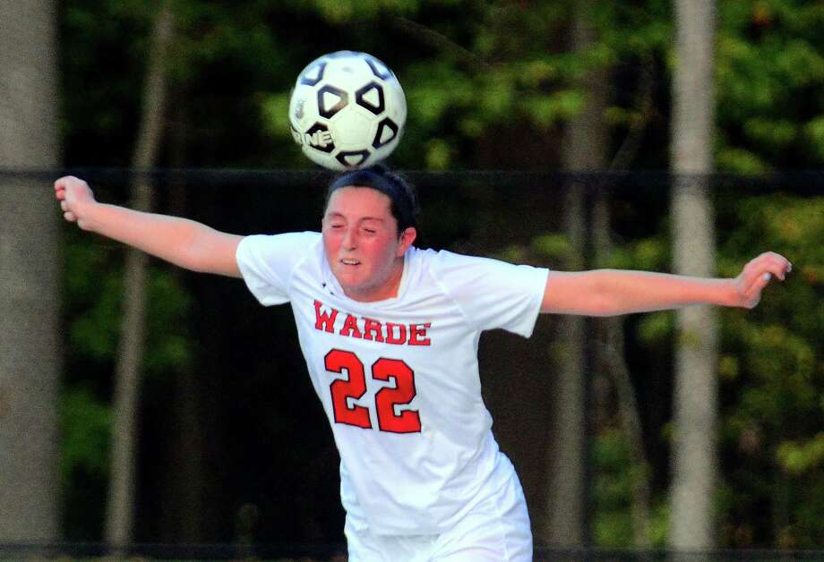 Fairfield Warde's Caroline Aufiero heads the ball in during girls soccer action against Trumbull in Trumbull, Conn., on Tuesday Oct. 9, 2018. Photo: Christian Abraham / Hearst Connecticut Media / Connecticut Post
