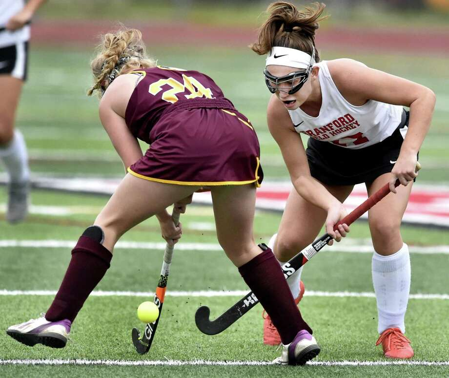 Branford's Molly Zaffino taps the ball between the legs of Molly Donegan of Sheehan at Branford in the Hornets 1-0 overtime win. Photo: Peter Hvizdak / Hearst Connecticut Media / New Haven Register