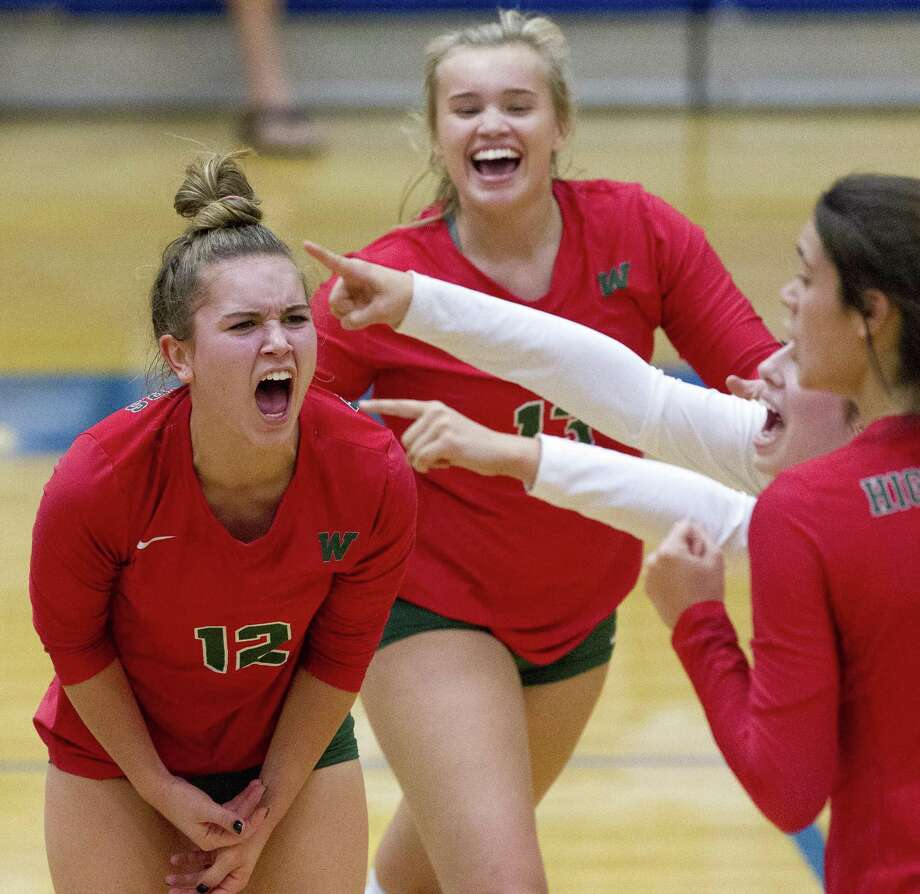 The Woodlands' Clara Brower (12) reacts with teammates after winning the second set of a District 15-6A high school volleyball match against Klein 25-23 at Klein High School, Tuesday, Oct. 9, 2018, in Spring. Photo: Jason Fochtman, Houston Chronicle / Staff Photographer / © 2018 Houston Chronicle