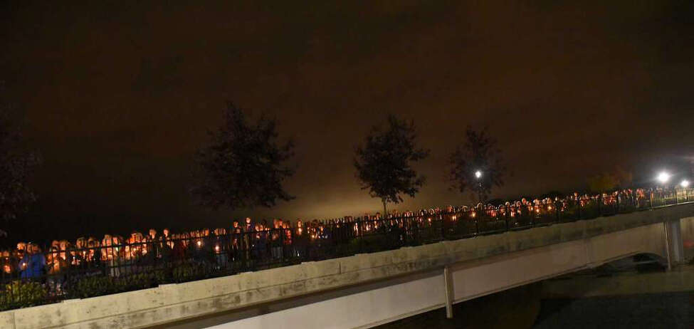 Mourners holding candles are seen on The Mohawk Valley Gateway Overlook during a vigil for the victims of the limousine crash in Schoharie on Monday, Oct. 8, 2018 in Amsterdam, N.Y. (Lori Van Buren/Times Union)