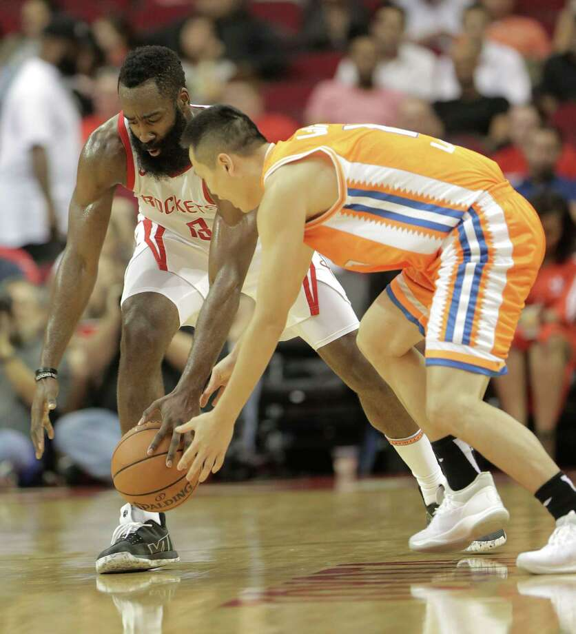 Houston Rockets guard James Harden (13) steals the ball from Shanghai Sharks forward Lu Wei (12) during the first half of preseason game  at the Toyota Center on Tuesday, Oct. 9, 2018, in Houston. Photo: Elizabeth Conley, Staff Photographer / © 2017 Houston Chronicle