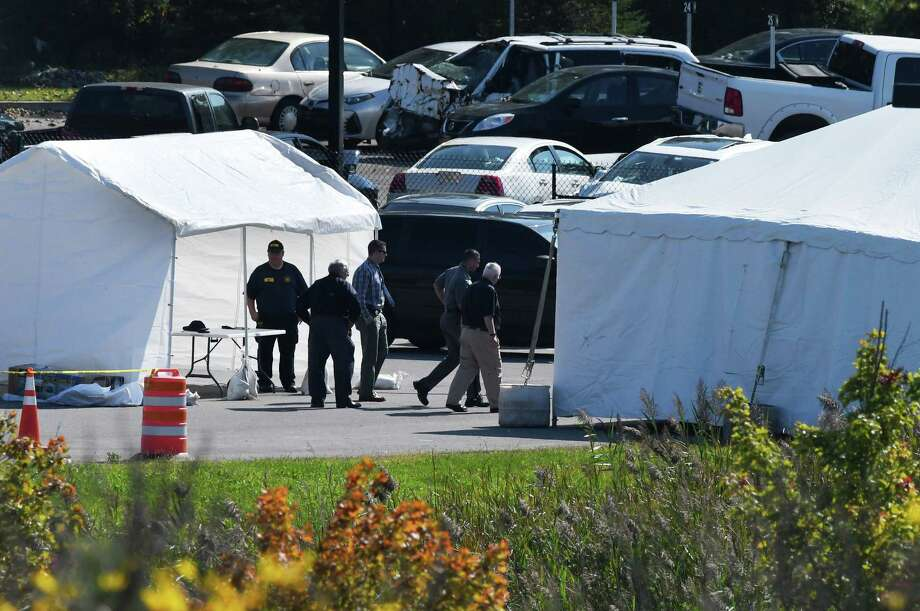 National Transportation Safety Board investigators and state police are examining the limousine that took the lives of 20 in Saturday's fatal crash in Schoharie County, as they search for answers under the cover of a tent, right, at State Police Troop G Headquarters on Tuesday, Oct. 9, 2018, in Latham, N.Y. (Will Waldron/Times Union) Photo: Will Waldron / 20045071A