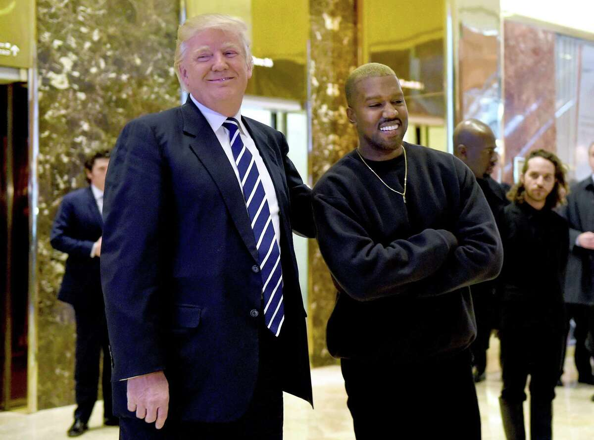 (FILES) This file photo taken on December 13, 2016 shows US singer Kanye West (R) and then-president-elect Donald Trump speaking with the press after their meetings at Trump Tower in New York. - Kanye West has decided on September 29, 2018 that he now wants to be called Ye, but on political matters nothing has changed for the pro-Trump rapper. (Photo by TIMOTHY A. CLARY / AFP)TIMOTHY A. CLARY/AFP/Getty Images