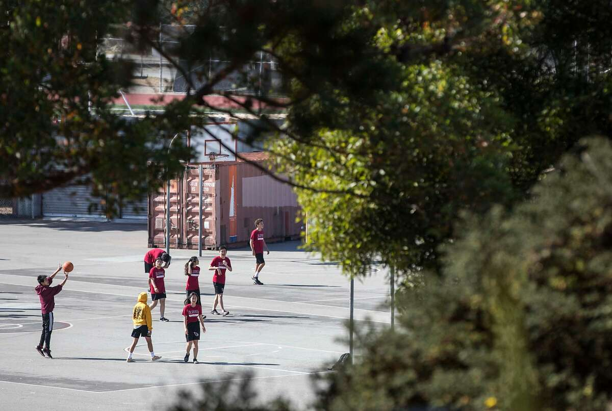 A student shoots a basketball during a physical education class at Lowell High School in San Francisco, Calif. Friday, Sept. 21, 2018.