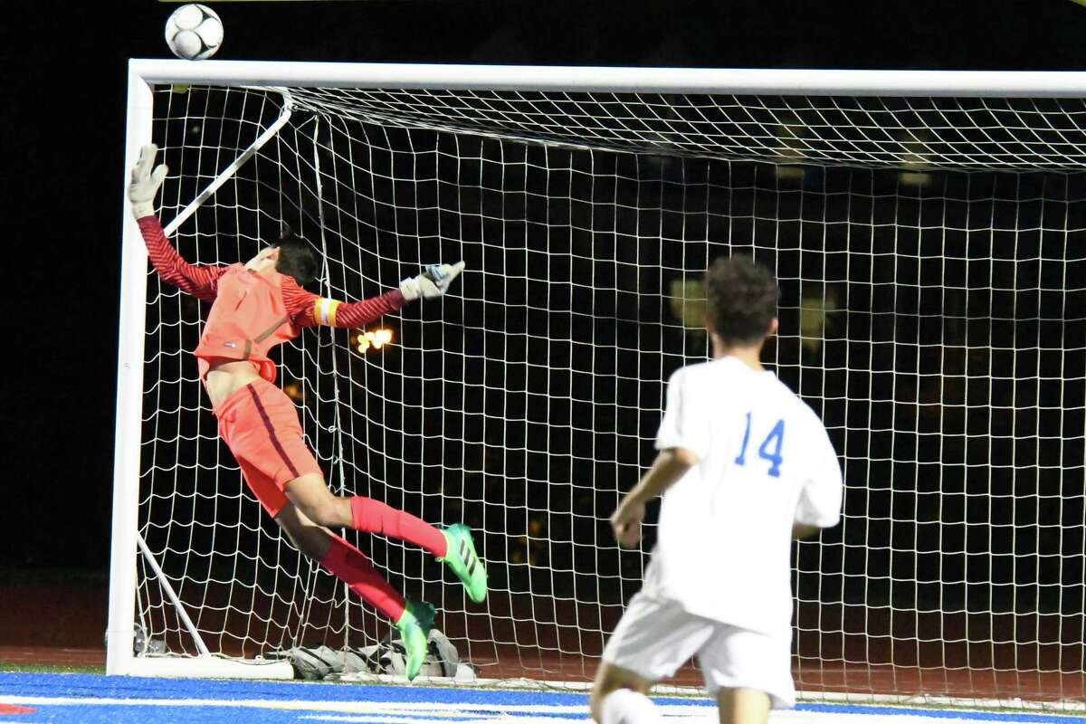 Shaker's David Blau looks on as Albany goaltender William Bulmer leaps backward to block a shot that bounces off the post during a game on Tuesday, Oct. 9, 2018 in Albany, N.Y. (Jenn March, Special to the Times Union )