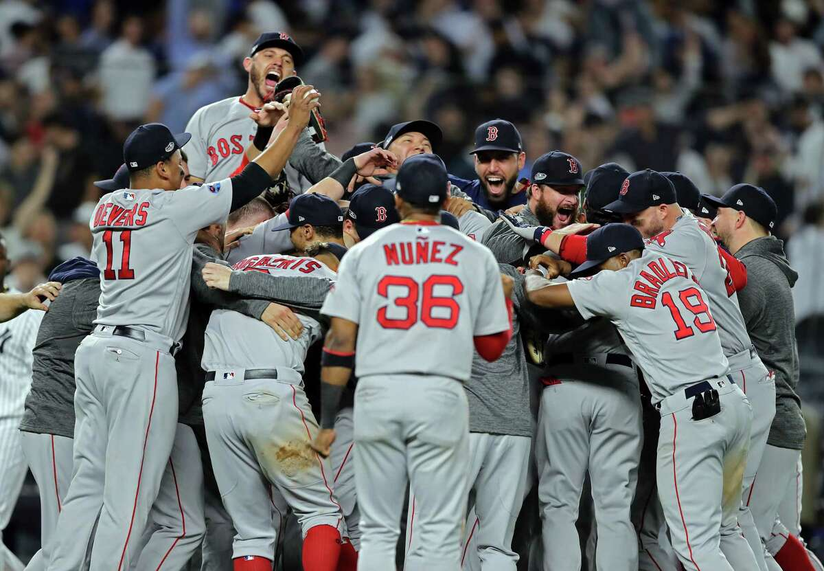 NEW YORK, NEW YORK - OCTOBER 09: The Boston Red Sox celebrate after beating the New York Yankees by a score of 4-3 to win Game Four American League Division Series at Yankee Stadium on October 09, 2018 in the Bronx borough of New York City. (Photo by Elsa/Getty Images)