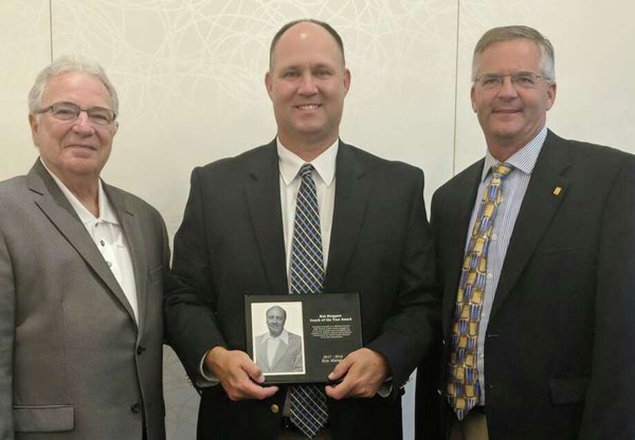 Midland High School varsity baseball coach Eric Albright, center, was presented the Bob Stoppert Coach of the Year Award by past recipient Frank Altimore, left, and Northwood University athletics director Dave Marsh, who is the chairmen of the Stoppert Award selection committee. (Courtesy photo)