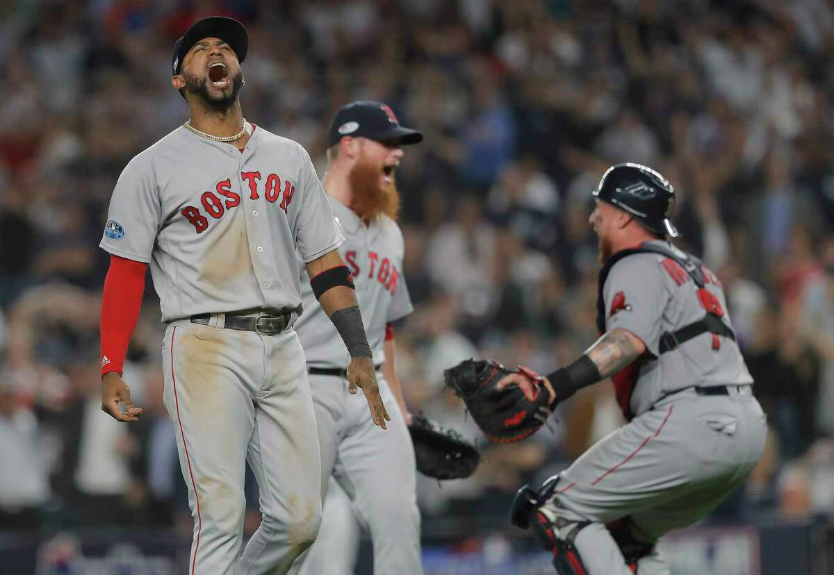 Boston Red Sox third baseman Eduardo Nunez, left, celebrates with relief pitcher Craig Kimbrel, center, and catcher Christian Vazquez after the Red Sox beat the New York Yankees 4-3 in Game 4 of baseball's American League Division Series, Tuesday, Oct. 9, 2018, in New York.