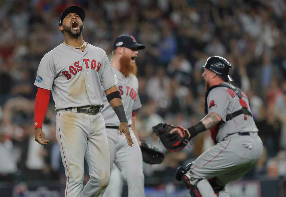 Boston Red Sox third baseman Eduardo Nunez, left, celebrates with relief pitcher Craig Kimbrel, center, and catcher Christian Vazquez after the Red Sox beat the New York Yankees 4-3 in Game 4 of baseball's American League Division Series, Tuesday, Oct. 9, 2018, in New York. Photo: Julie Jacobson, AP / Copyright 2018 The Associated Press. All rights reserved.