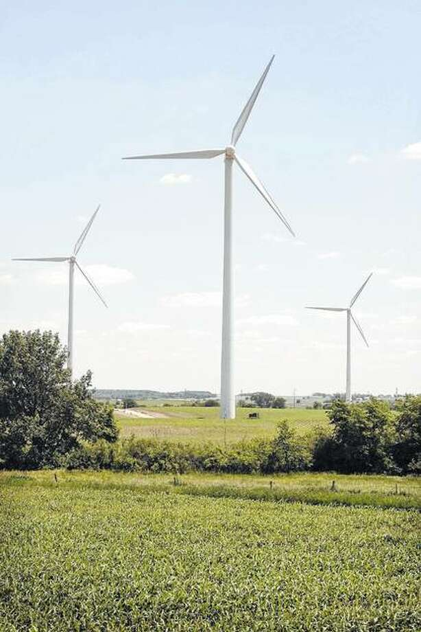 Power-generating windmills tower over a farm near Steward. The windmills are part of a 63-turbine wind farm that has been in operation since 2003 in this rural area of northern Illinois. Photo: Scott Olson | Getty Images