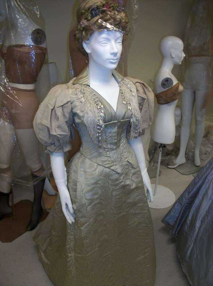 """This cream dress was in style in 1892, and would likely have been worn by a Darien woman at the time. In this fall's """"The Ladies of Prospect Ave."""" exhibit at the Darien Historical Society, it will serve as an example of what the woman who lived at 20 Prospect Ave. would have worn. Photo: Maggie Gordon / Darien News"""