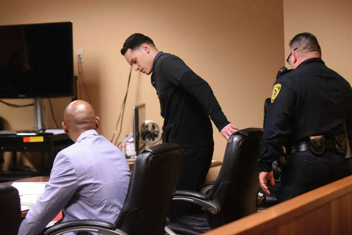 Defendant Adrian Vigil, who is accused of two counts of super aggravated sexual assault on a minor, enters the courtroom of Judge Philip A. Kazen on Tuesday, Oct. 9, 2018.