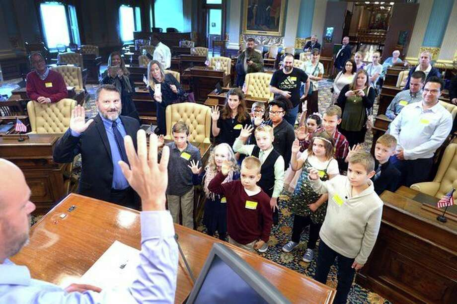 Winners of the 2018 Be a Senator for a Day summer reading contest and their parents participate in a mock swearing-in ceremony on the Senate floor in Lansing. The contest was sponsored by Sen. Phil Pavlov, R-St. Clair Township. The 'junior senators' also participated in a committee hearing and a guided Capitol tour. (Submitted Photo)