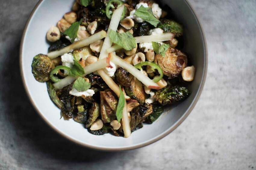 Crispy Brussels sprouts with hazelnuts, chile sauce and fresh ricotta at Eunice.