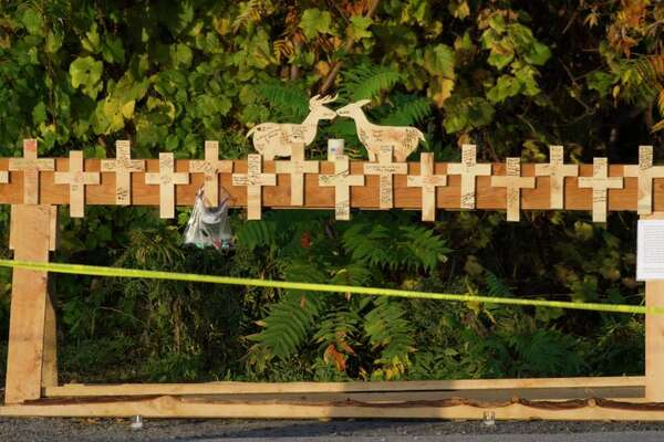 People have written messages and signed their names on a memorial that was put up near the scene of the limousine crash that left 20 people dead Saturday at the intersection of routes 30 and 30A in Schoharie.