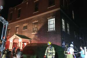 Stamford firefighters extinguished a basement blaze Tuesday night at Glenbrook industrial building.
