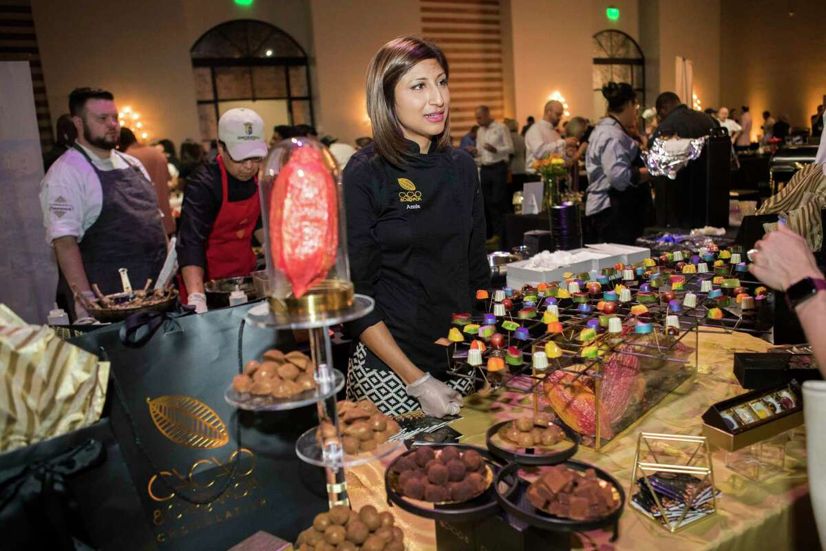 Chocolatier Annie Rupani offering samples of her chocolates at The Epicurean Project, Monday, Oct. 8, 2018 in Houston.