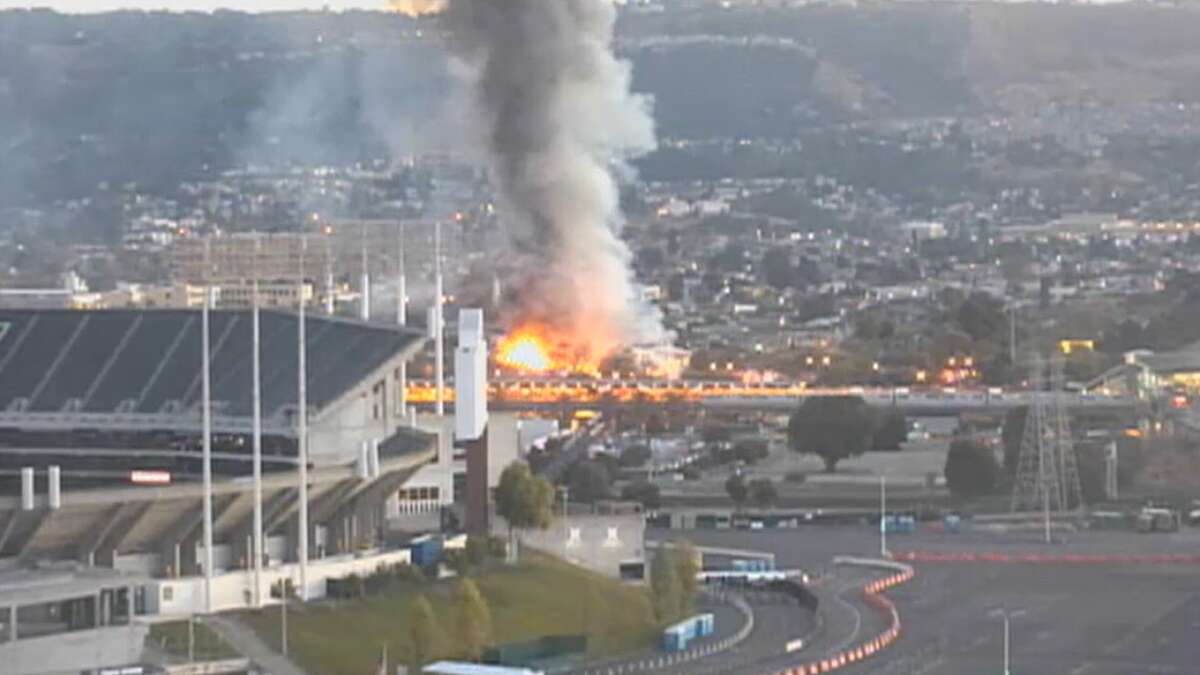 A fire erupted at a warehouse early Wednesday in Oakland near the Coliseum.