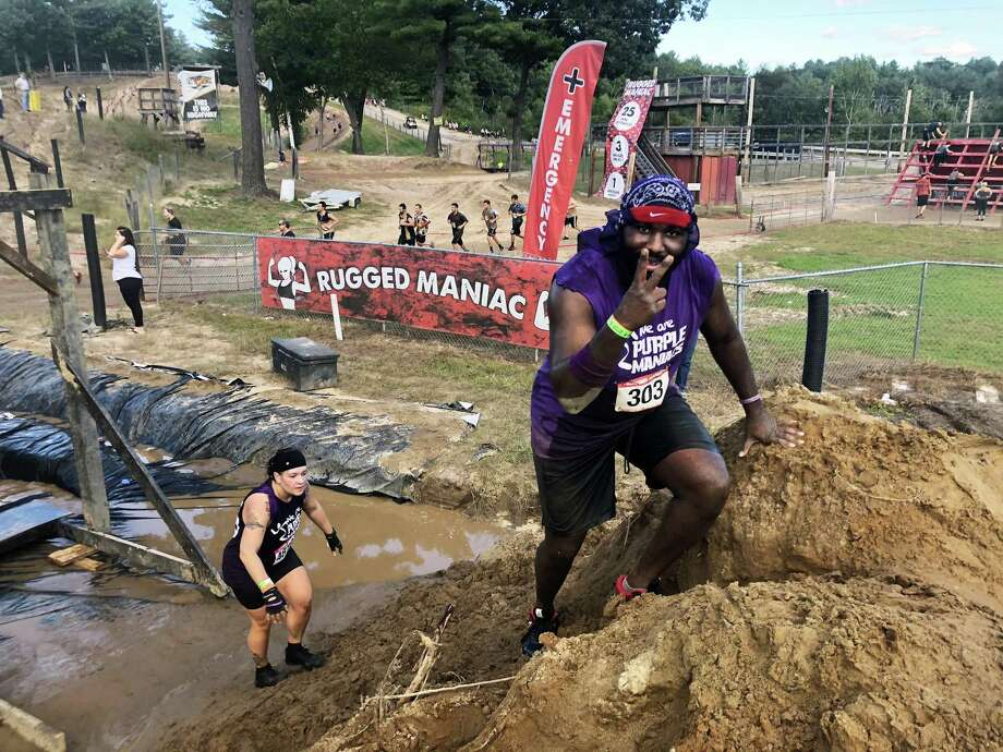 Over 280 Anytime Fitness members and employees took part recently in the 5K Obstacle Race and Mud Run: Rugged Maniac in Massachusetts. Photo: Contributed Photo