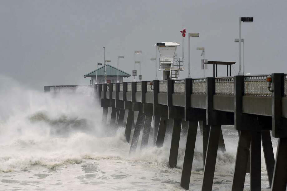 Heavy surf from the approaching Hurricane Michael pounds the fishing pier on Okaloosa Island in Fort Walton Beach, Fla., on Wednesday, Oct. 10, 2018. (Devon Ravine/Northwest Florida Daily News via AP) Photo: Devon Ravine, Associated Press