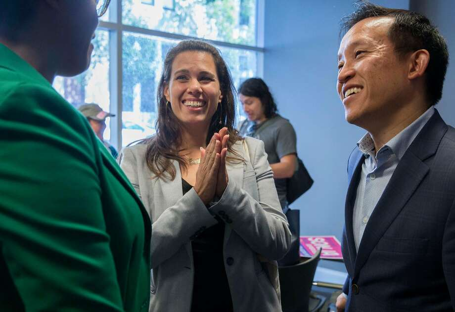 Sonja Trauss (center) chats with fellow District Six supervisorial candidate Christine Johnson and Assemblyman David Chiu at a canvassing event. Trauss and Johnson are running on a joint, ranked-choice ticket. Photo: Jessica Christian / The Chronicle