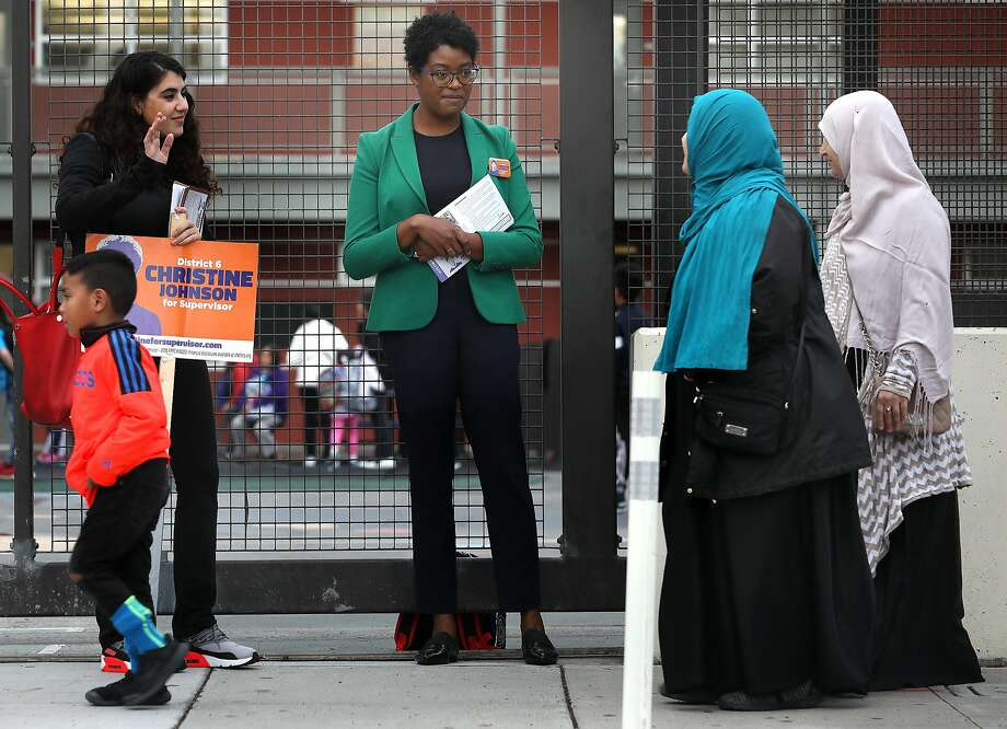 District Six supervisorial candidate Christine Johnson (center) canvasses with her campaign coordinator, Miriam Zouzounis (left) at Bessie Carmichael Elementary School in SoMa. Photo: Liz Hafalia / The Chronicle